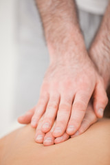 Osteopath massaging his patient while pressing his back