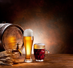 Wall Mural - Beer barrel with beer glasses on a wooden table.