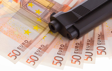 A gun on top of some 50 euro banknotes
