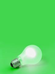Lighting lamp on green background