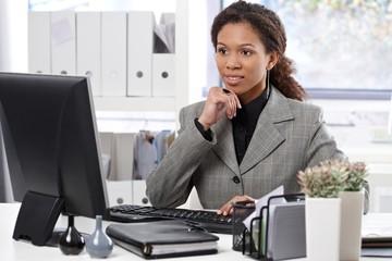 Attractive businesswoman working in office
