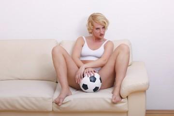 female soccer fan with a soccer ball