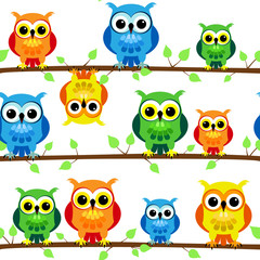 Seamless owls on tree branch
