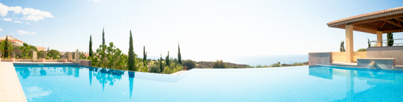 Luxury swimming pool. Panoramic image