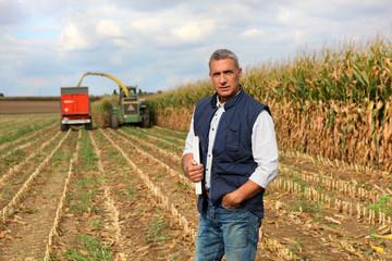 Farmer posing in his field