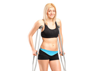 An injured young female on crutches