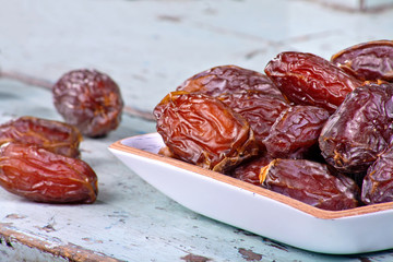 Dried dates on wooden background