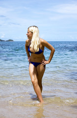 Attractive blonde playing on the beach