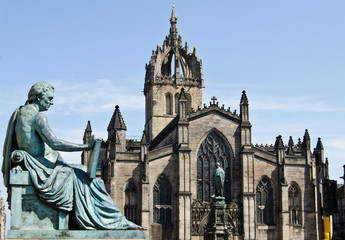 St. Giles Cathedral (High Kirk of Edinburgh) with David Hume Statue in foreground on Royal Mile in Edinburgh, Scotland