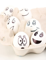White eggs with funny faces