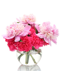 Bouquet of carnations and peonies in glass vase isolated