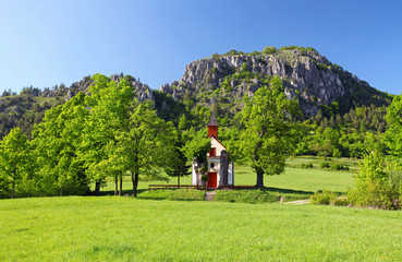 Spring landcape with mountain and chapel in eastern europe