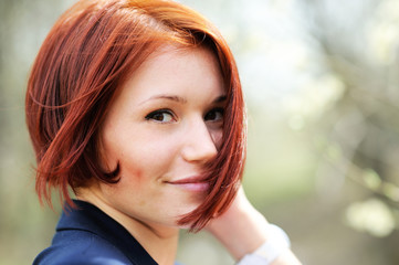 Closeup portrait of beautiful woman with red hair