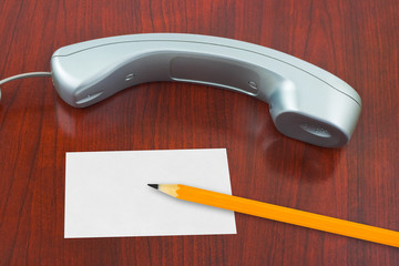 Phone, paper card and pencil