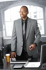 Elegant businessman at office desk