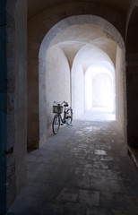 Wall Mural - old arcade and bicycle