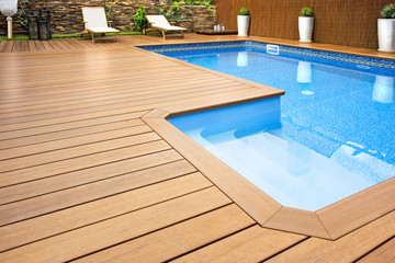 Obraz Blue swimming pool with  wood flooring-Piscina madera - fototapety do salonu