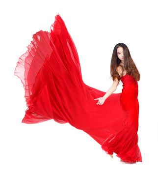 Young Woman in Flowing Red Dress on White Background