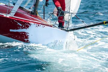 skipper on bow at regatta