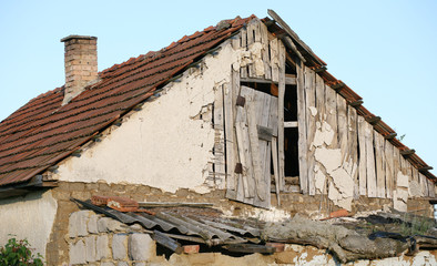 Damaged roof.Old farmhouse.