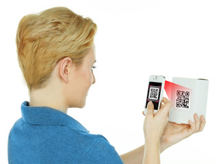 Woman scans a scancode with her white cellphone