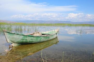 wooden kayak on lake