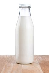 Bottle of fresh milk is wooden table Isolated on white backgroun