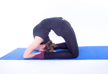 Young pretty woman doing yoga exercise