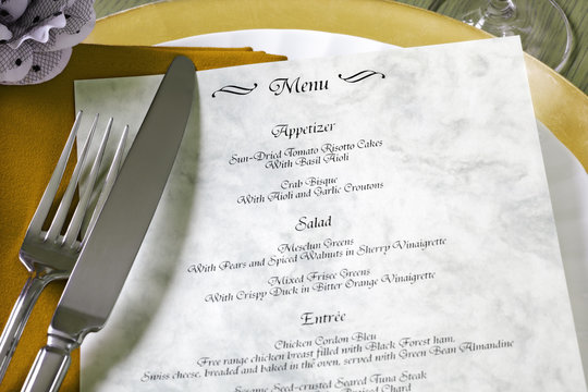 Menu and cutlery on restaurant table