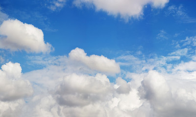 Background of azure sky with clouds on beautiful summer day