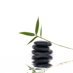 Stones with bamboo leaf with reflection