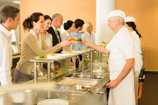 Office woman in canteen cook serve meals