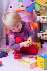 Girl in playing room with toys