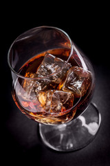 Whiskey / Cognac on black background