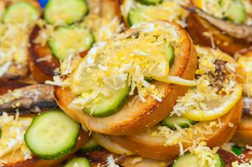 sandwich with sprat, egg, cucumber and lemon. Fresh snack