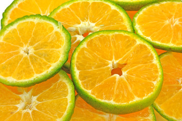 fresh slices of orange piled on white