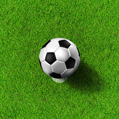 Football ( soccer  ball ) in grass field.