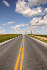 country road to freedom with yellow line