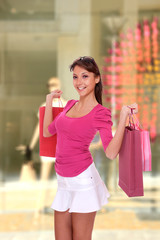 Woman in front of a shop Window