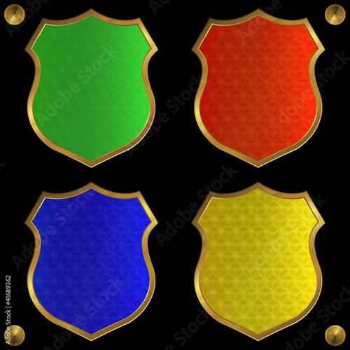 quotgreenredblue and yellow shields on a black background