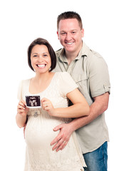 Happy pregnant couple with ultrasound picture