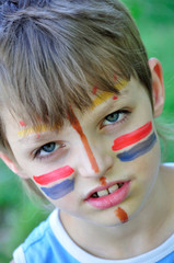 football fan child with painting on his face
