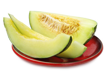Melon slices on a red plate