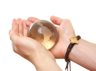 Male hand holding glass sphere in hand