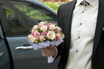 Wedding Bouquet in a Groom's Hand