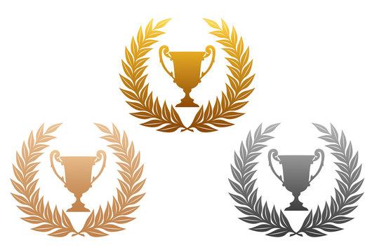 Golden, silver and bronze laurel wreaths with trophy