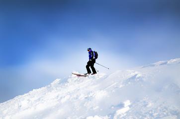 Skier at the peak of mountain