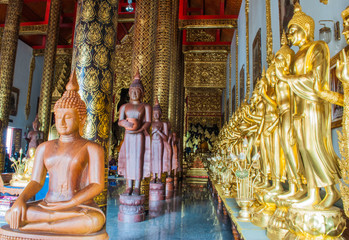 golden buddha statue image in Thai Temple, Thailand