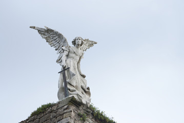 Statue angel with wings and sword