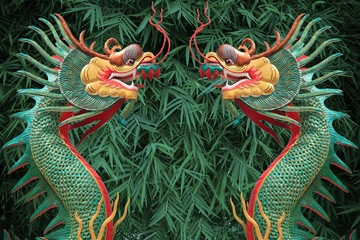 face of twin dragon on green bamboo leaves background